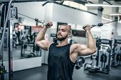 Brutal Strong Athletic Men Pumping Up Muscles Workout Bodybuilding Concept Background - Muscular Bod poster