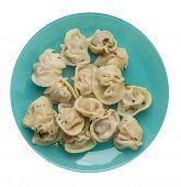 Dumplings On A Turquoise Plate Isolated On White Background .boiled Dumplings.meat Dumplings Top Vie poster