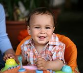 foto of dark-skin  - Cute toddler boy smiling and playing with toys