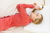 Exhaustion Laziness Relax Concept. Girl Rolling In Bed. Lazy Youthful Lady Wearing Red Dotted Pajama poster