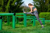 Fitness Woman Stretch Legs, Do Warm-up Before Running Workout Workout Outdoor. Athlete Stretches Ham poster