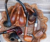 image of peace-pipe  - several different smoking pipes  - JPG