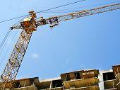 Crane. Self-erecting Crane. Hoisting Crane. Construction Crane Against Blue Sky. poster