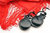 stock photo of castanets  - Ornaments made flamenco castanets on colored fabrics - JPG