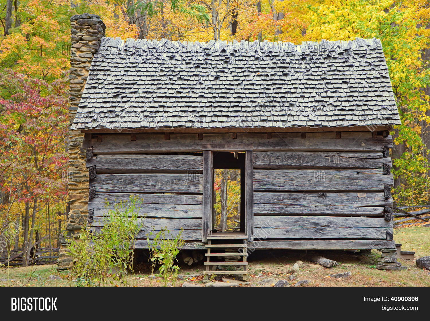 Old one room log cabin during autumn in smoky mountains for One room log house