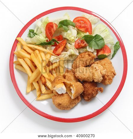 A meal of homemade kingfish nuggets served with french fried potato chips and a salad of tomato, lettuce and rocket.