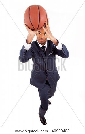 Black young business man playing basketball, isolated on white