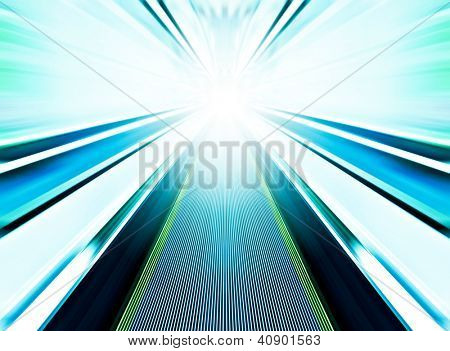 Perspective wide angle view of modern light blue illuminated and spacious high-speed moving commercial escalator with fast blurred trail of handrail in vanishing traffic motion in airport corridor