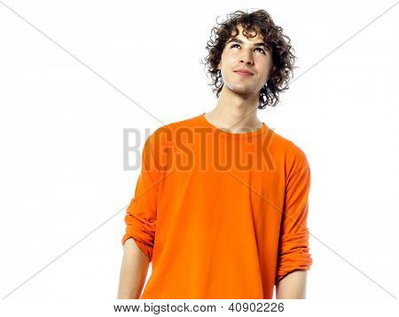 one young man suspicious  caucasian looking up portrait  in studio white background