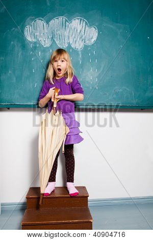 Surprised Young Girl With Umbrella Indoors