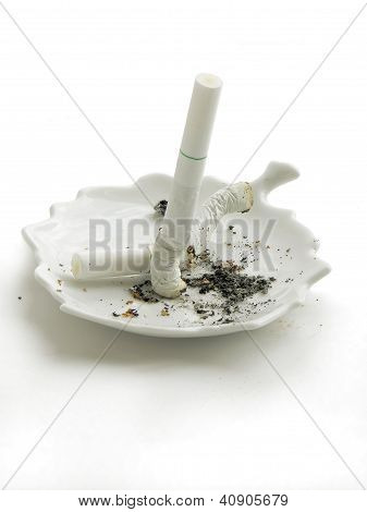 smoked cigarette and ash-tray