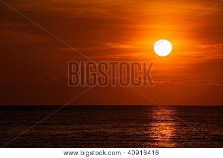orange sunset over a calm sea