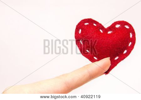 Red Heart In Fingers