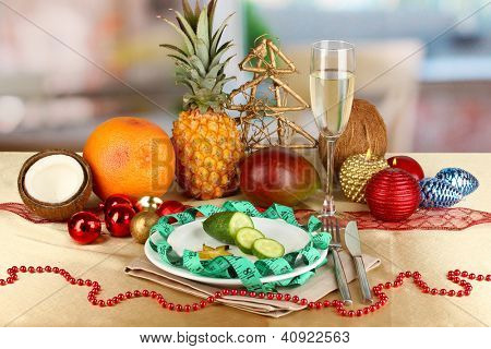 Dietary food on New Year's table on room background