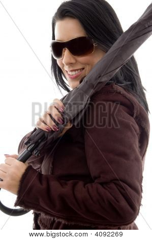 Side View Of Female Holding Umbrella On White Background