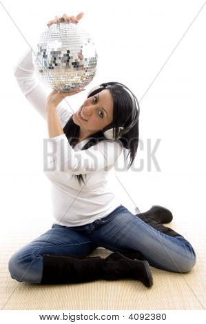 Front View Of Smiling Woman Showing Disco Ball