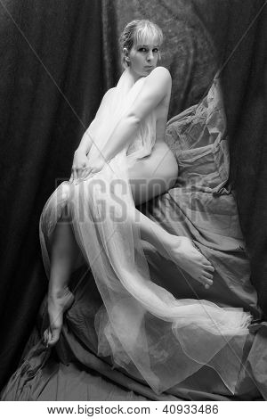 Flirty girl in net veil. Vintage style black and white photography.