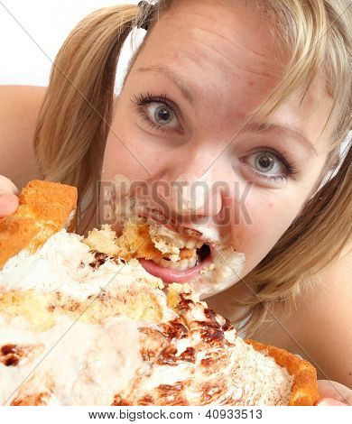 The girl greedy eats sweet pie. Weight loss concept.