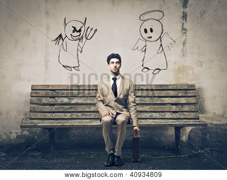 Businessman sitting on a bench with an angel and a devil on his sides