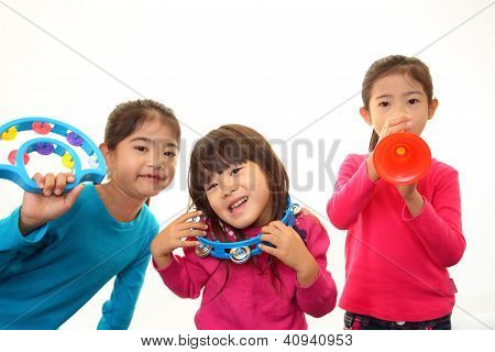 Smiling girls with musical instruments