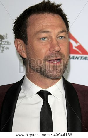 LOS ANGELES - JAN 12:  Grant Bowler arrives at the 2013 G'Day USA Los Angeles Black Tie Gala at JW Marriott on January 12, 2013 in Los Angeles, CA..