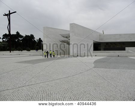 Pilgrims enter the Church of the Holy Trinity in Fatima, Portugal