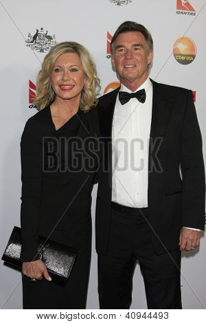 LOS ANGELES - JAN 12:  Olivia Newton-John, John Easterling arrives at the 2013 G'Day USA Los Angeles Black Tie Gala at JW Marriott on January 12, 2013 in Los Angeles, CA..
