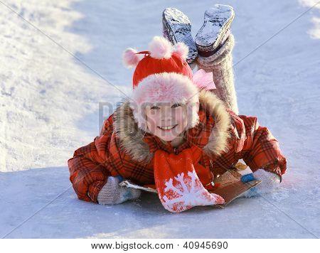 Girl Sliding Down A Frozen Hill
