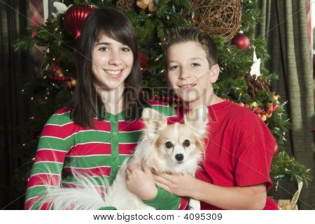 Happy Siblings With Pet