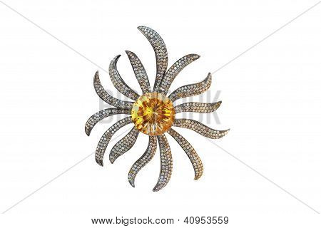 golden brooch with citrine and diamonds