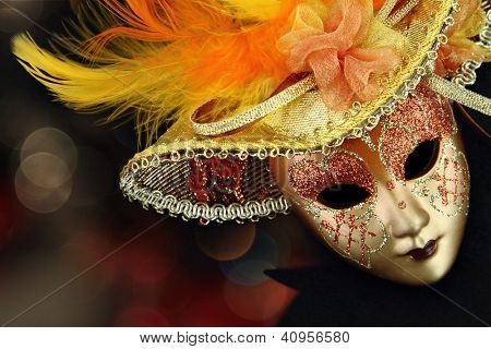 Vintage carnival mask in front of lights background
