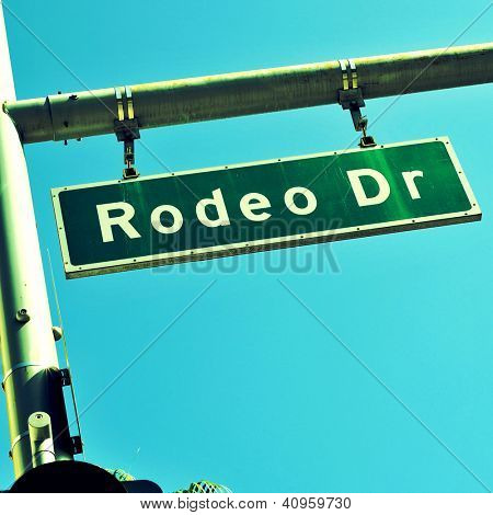 a Rodeo Drive sign over the blue sky, in Beverly Hills, US