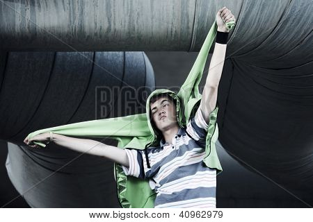 Crazy young man against industrial background