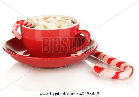 Cup of coffee with holiday candy isolated on white