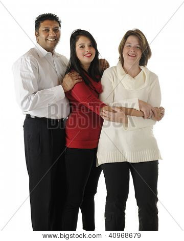 Standing portrait of a happy biracial family ...an Asian Indian father, caucasian mother and their pretty teen daughter.  On a white background.