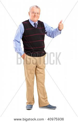 Full length portrait of a smiling mature man giving a thumb up isolated on white background