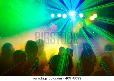 Crowd Dancing Under Disco Laser Beam.