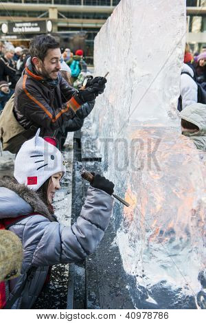 LONDON, UK - JANUARY 13: Public activity at the London Ice Sculpture Festival, in Canary Wharf. Visitors were invited to carve this block of ice. January 13, 2013 in London.