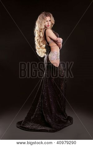 Portrait Of Young Elegant Girl With Smart Fair Hair In Long Dress