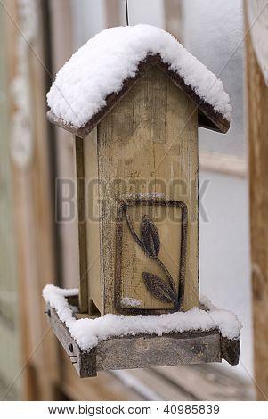 Snow On An Empty Bird Feeder