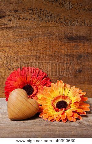Gerbera and wooden heart