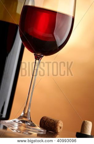 glass of red wine and the wine bottle
