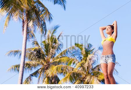 beautiful young woman relaxing at the tropical resort