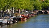 picture of sabbatical  - a shot of Amsterdam canals and typical boat - JPG