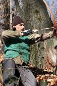 picture of longbow  - man with a longbow in the woods - JPG