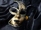 stock photo of venice carnival  - Gold a carnival mask with black feathers - JPG