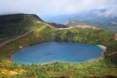 stock photo of fukushima  - Blue pond and tinted autumn leaves - JPG