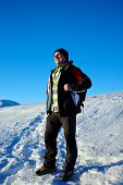 picture of bagpack  - Hiker with bagpack on his way in the mountains on a winter day - JPG