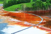 stock photo of greenpeace  - Nature pollution of a copper mine exploitation - JPG