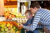 stock photo of department store  - cheerful family of two at the farmers market